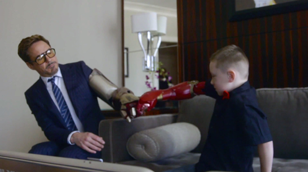 Robert Downey Jr delivers bionic arm to real-life boy