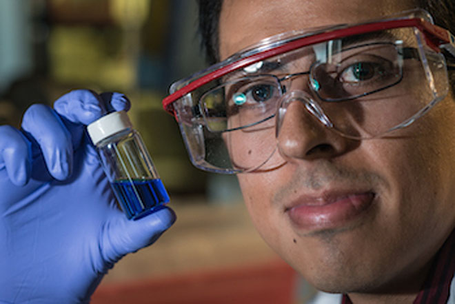 Graduate student and study lead author Victor García-López shows a vial with millions of nanosubmarines