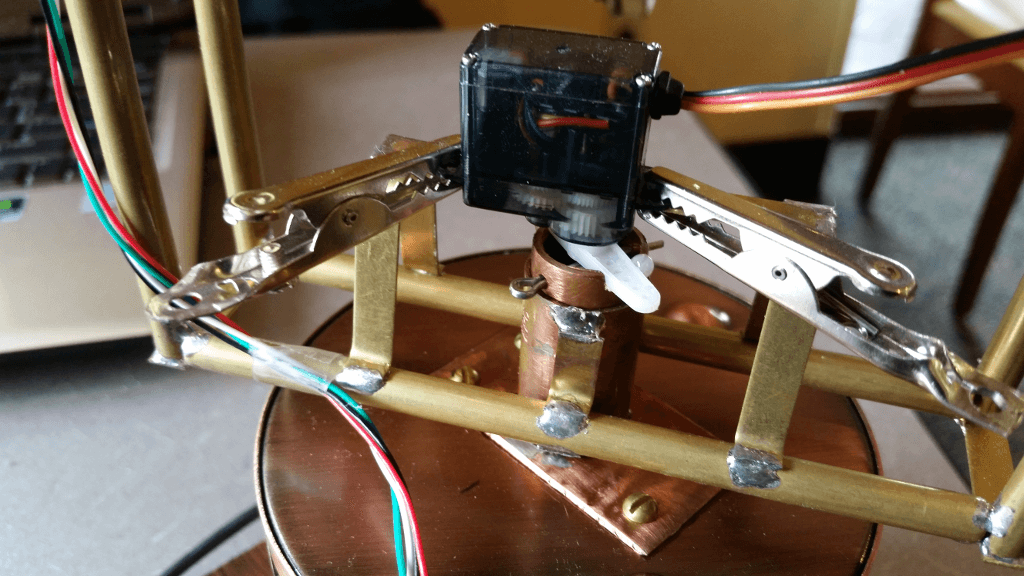 The cotter pin and servo mount temporary alligator clips