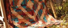 """A king-size quilt, """"When God Made Me Born a Yankee, He Was Teasin'"""" by Jennifer Fulton."""